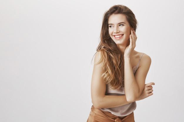 elegant woman laughing flirty looking left 176420 17650 - Realistic dildos: Usage
